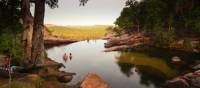 Relaxing in the waterhole above Gunlom Waterfall on the Kakadu Walking Adventure | Rhys Clarke
