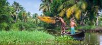 Villagers fishing in the backwaters near Kerala | Richard I'Anson